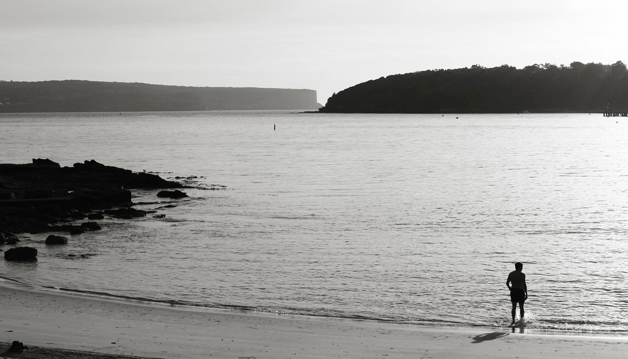 Man entering Sydney Harbour for a early morning swim